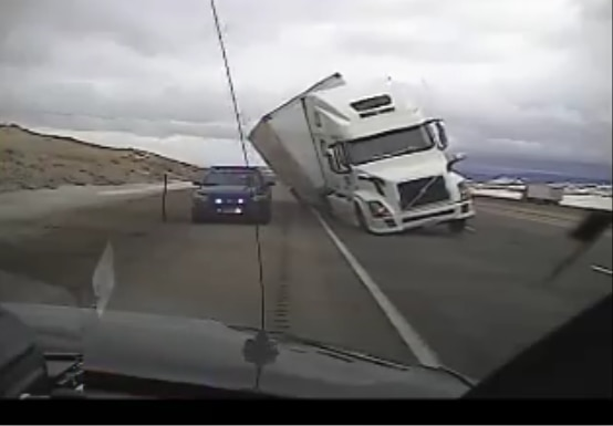 Semi Crushes Wyoming State Patrol Car During High Winds