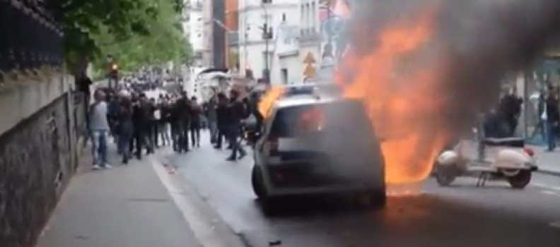 American Charged for Torching French Police Car